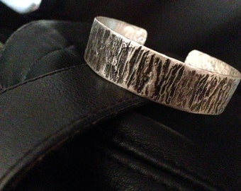 Artisan-created sterling cuff bracelet