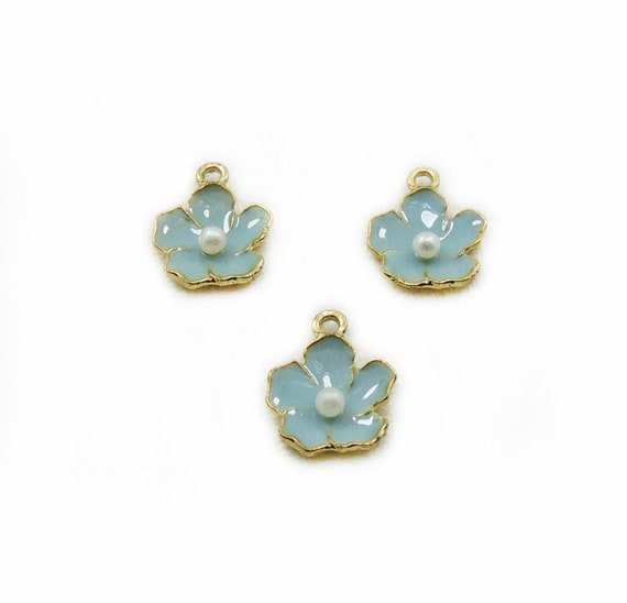 Tiny enamel flower charms blue enamel flower charms flower for Gemsprouts tiny plant jewelry