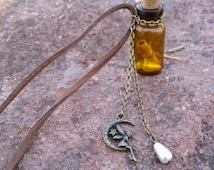 Brown Glass Wish Bottle with Fairy Charm Necklace/rear view mirror charm.