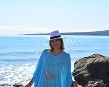 Turquoise free flowing beach kaftan with silver hibiscus flower