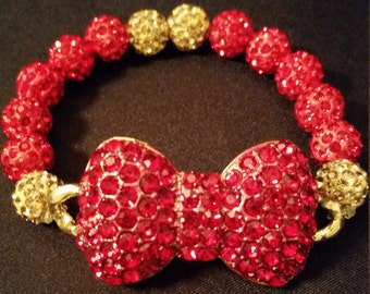 Red and Gold rhinestone beaded stretch bracelet with red rhinestone bow