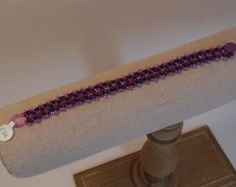 Handmade, woven, beaded bracelet, in magenta and jewel metallic colors;