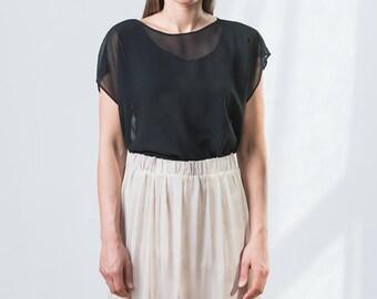 Black oversize transparent top with longer back