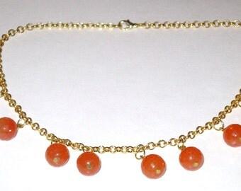 Handmade orange jade bead charm necklace on gold plated chain