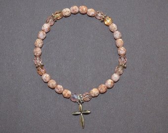 CLEARANCE Bracelet, 7.5 inch pink beaded stretch bracelet with a cross charm