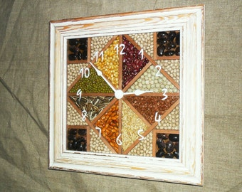 Clock with natural seeds in wooden frame