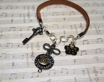 Leather Bracelet with Dangling Charms.