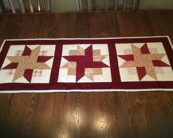 Handmade quilted country table runner in cranberry and beige stars