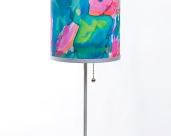 Lamp with custom lampshade based on unique hand painted textile