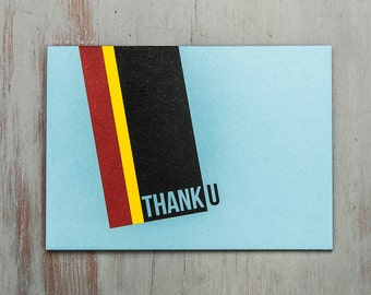 Thank you typographic A6 greetings card with stripes in red, yellow, black on a blue background original