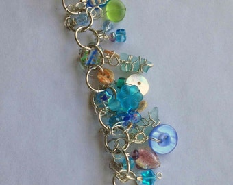 Unique, wire-wrapped ocean glass Charm Bracelet by Heather
