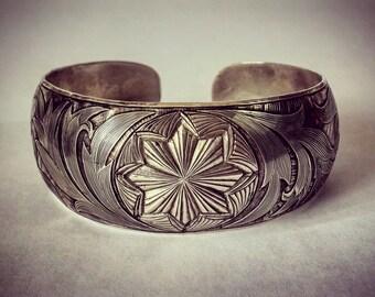 Female silver bracelet handmade engraved .