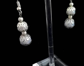With its White Pearl Earrings