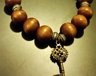 Womens' Wooden Beaded Bracelet With Key Charm