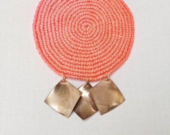 Light pink fluorescent macramé necklace with copper charms