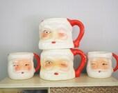 Set of Four Vintage Winking Santa Mugs