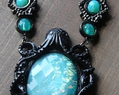 Neo victorian Goth Jewelry - Necklace - Black Octopus with Aqua Opalescent Pendant and Uranium glass beads - Black Gun metal