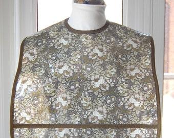 Elegant Floral Extra Large Adult Bib - vinyl covered extra-large bib with pocket