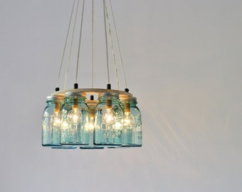 Mason jar chandelier etsy mason jar chandelier lighting fixture 7 antique aqua blue quart jars rustic ring mason aloadofball Image collections
