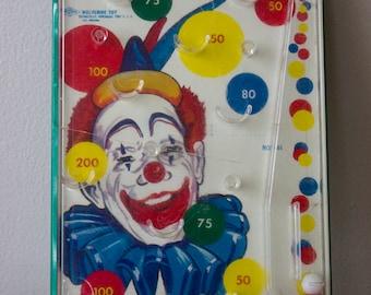 Jocko the Clown Handheld Tin Pinball Game 1960's