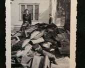 Vintage Photo - Woman Sitting on a Pile of Chopped Wood