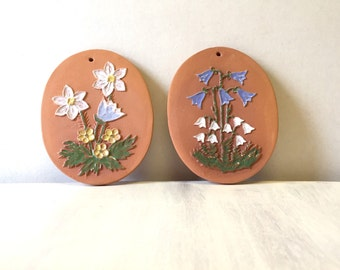 A pair of clay flower wall plaques, blue bell snowdrop flower design, clay wall art, flower wall art, decorative terracotta clay wall tiles