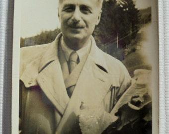 Vintage 50's Photo - Man Stood Holding a Plant/Vegetable