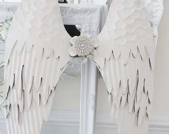 Beautiful Metal Angel Wings painted with chalk paint and embellished with a little bling