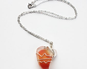 Art glass pendant with wire-wrapped tangerine orange glass and silver wire