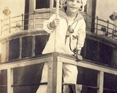 Cute Child in King Of The World Pose STANDING On BOW Of BOAT Studio Arcade Novelty Photo Postcard Long Beach California circa 1915
