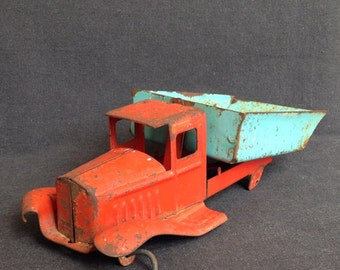 Daddy's old truck. Very vintage used wrecked toy truck.