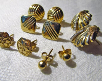 Five pairs tiny gold stud earrings