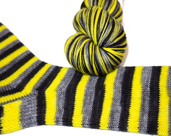fingering weight yellow, black and gray self-striping sock yarn | Merlin in Sword in the Stone | merino nylon blend selfstriping yarn