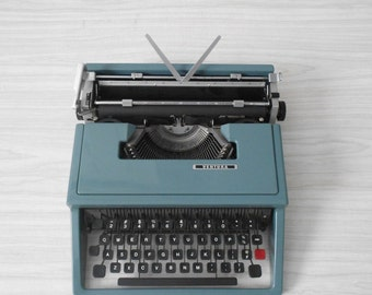 vintage small retro blue ventura manual typewriter / portable / office