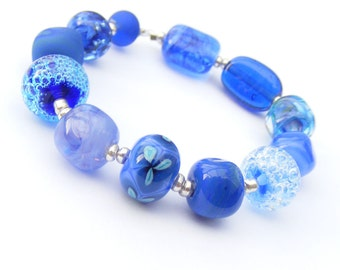 Handmade lampwork glass bead set of 12 blue, cobalt and navy orphan beads - blue renegades