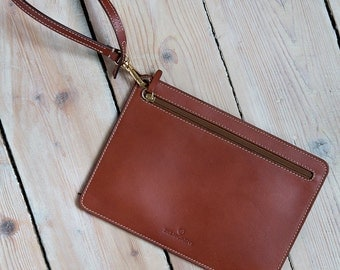 Caramel brown leather clutch with hand strap