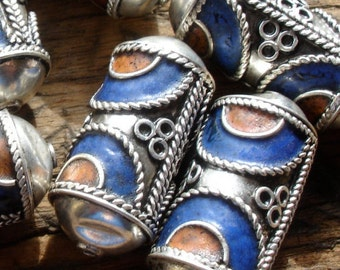 Enamel Moroccan tarnished  ornate barrel bead with small dents in the end