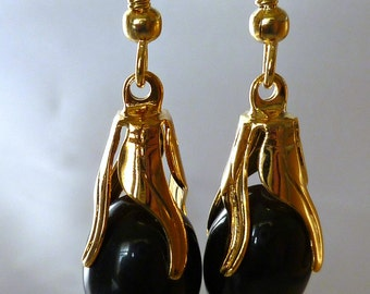 Handmade black catseye dangle earrings with gold accents