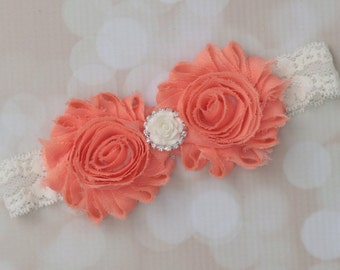 Peach and lace shabby flower headband with an ivory rose and rhinestone center. Perfect for newborn to adult! Soft stretch lace.