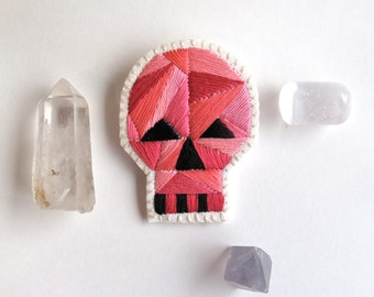 Halloween skull brooch with pink geometric design hand embroidered on cream muslin and cream felt Halloween Day of the Dead