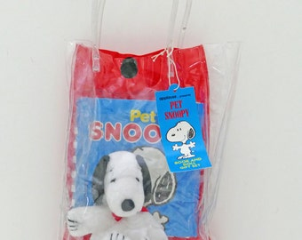 Pet Snoopy Book and Doll in Plastic Bag.