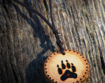 Wolf paw print pendant.