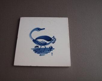 Delft tile trivet hand painted blue bird tile coaster trivet Mastricht souvenir artist signed WV Delft coaster vintage Delft blue goose swan