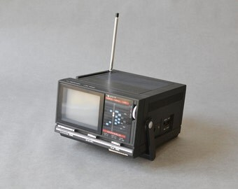 Vintage tv television black portable 80s min tv