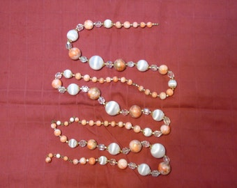Garland made from a vintage necklace 4 feet orange white and crystal