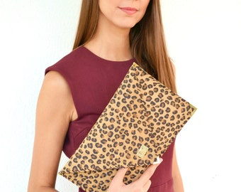 Suede leather clutch with a leopard print