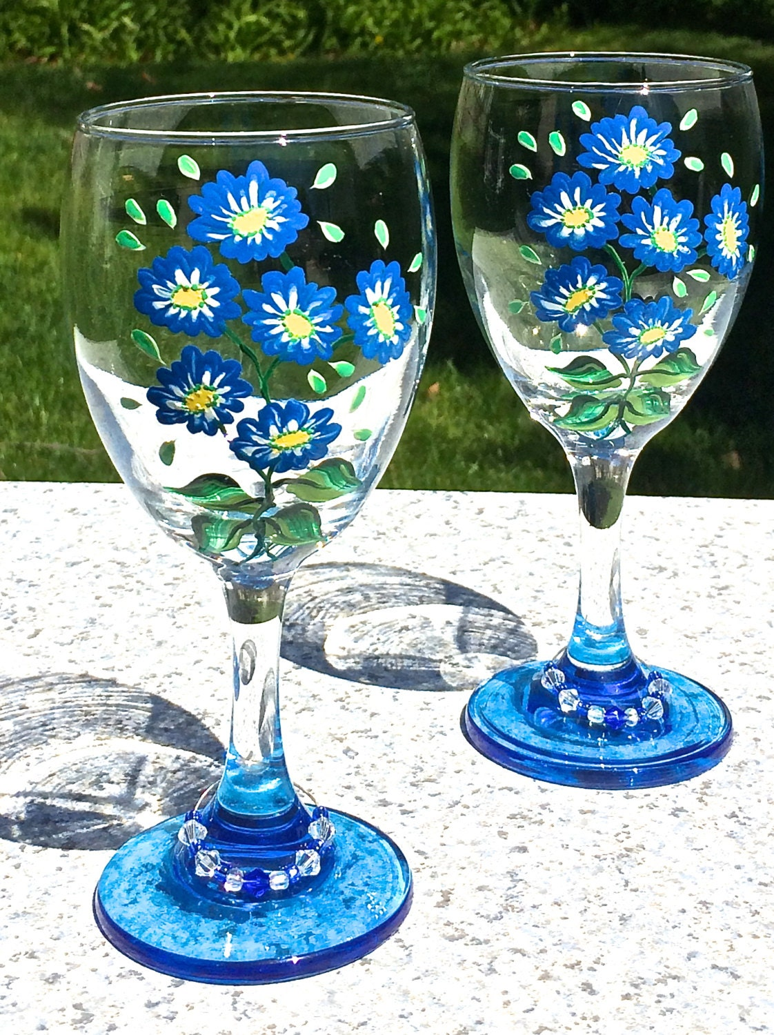 Wine glasses hand painted blue flowers and wine glass charms for Painted wine glasses