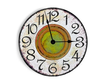 White wall clock with green and rust middle. Circle design.