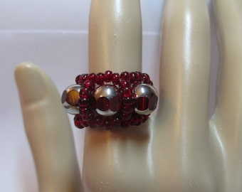 Ring burgundy seed beads with round burgundy silver 8MM crystal beads on stretchy cord size 7 to 8
