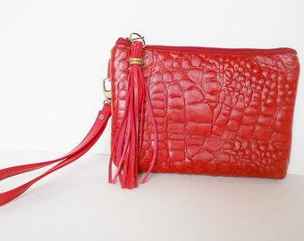 Red leather wristlet or clutch in embossed crocodile.